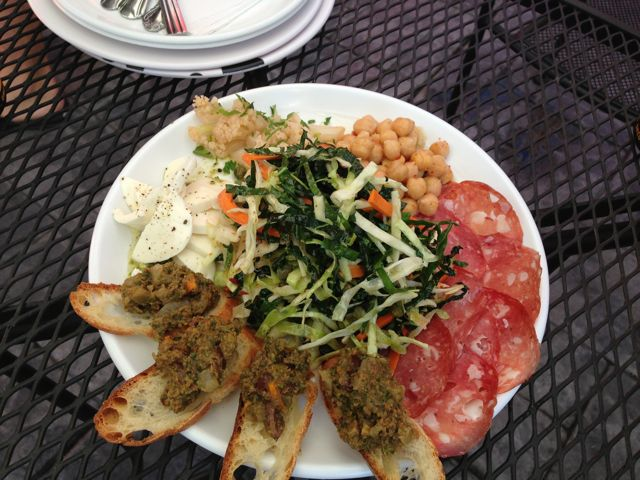 Olive tapenade, Salami, spicy chickpeas, marinated cauliflower, fresh mozzarella with pesto and salad.
