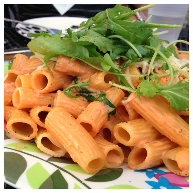 Pasta tossed with a tomato cream sauce. A very large serving.