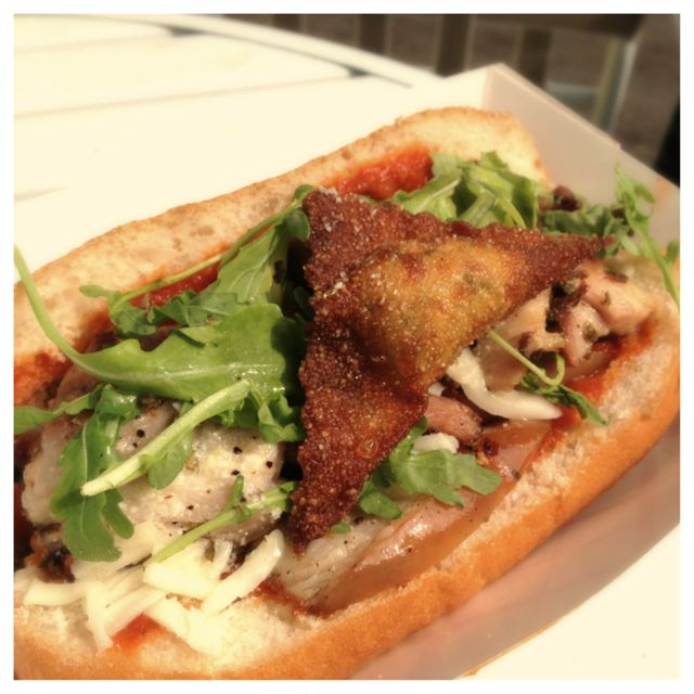 Porchetta Sandwich from Certo topped with handmade fried ravioli