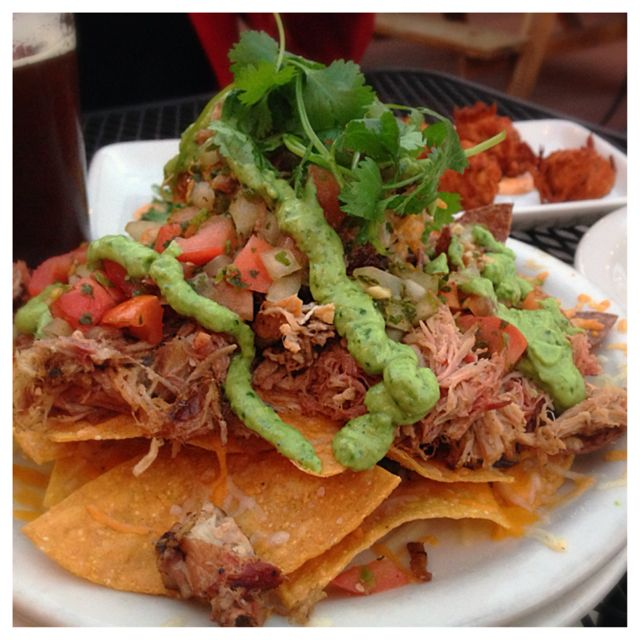 Pork Carnitas Nachos with Avocado Creme from The Station
