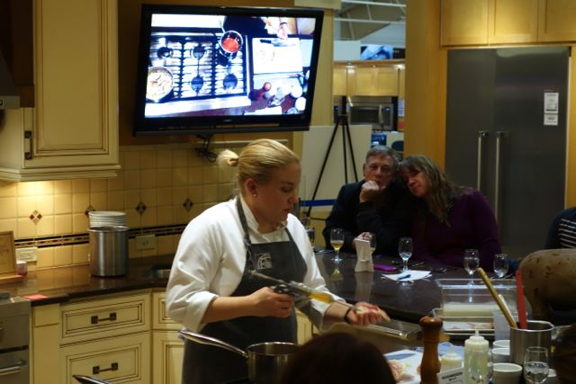 Chef Sarah showing us how she makes her chicken extra moist.